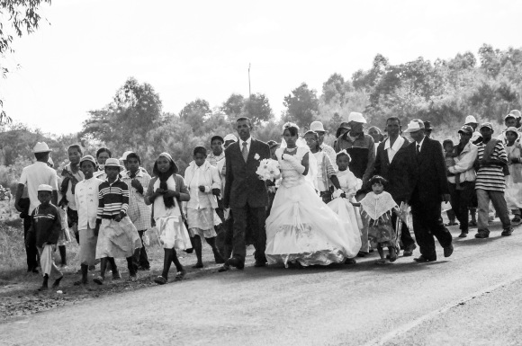 We encountered a tradition where the wedding attendants all walk together to the church.